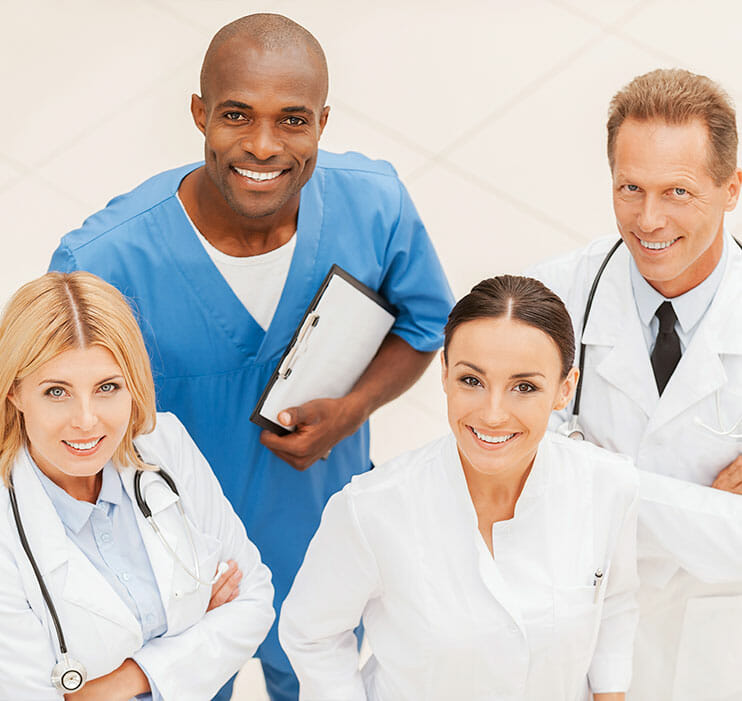 health care providers looking up at camera